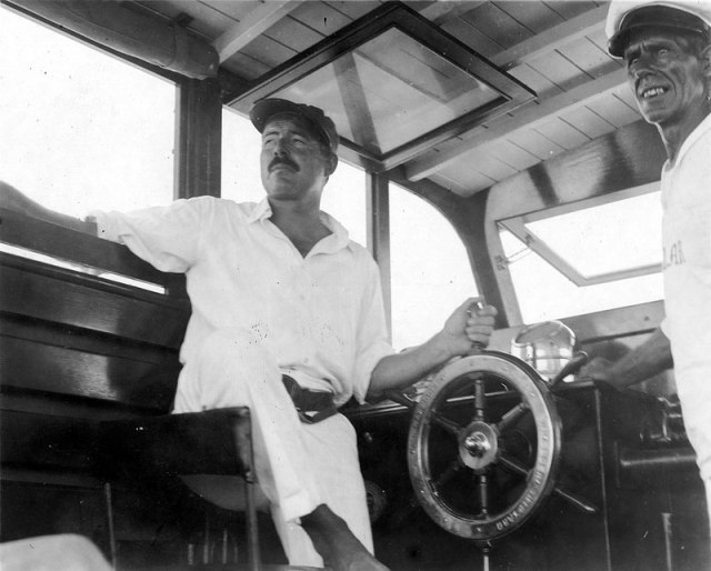 11-Ernest-Hemingway-at-the-wheel-of-Pilar